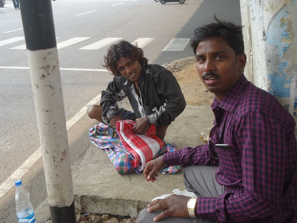 Blessing a blanket for a road side man